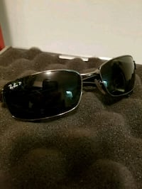 black framed sunglasses with case 3490 km