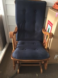 brown wooden framed blue padded glider chair