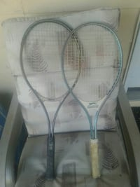 two gray-and-blue tennis rackets Surrey