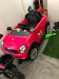 red and black Mini Cooper ride-on toy car SINGAPORE