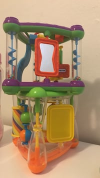 green, red, and yellow plastic toy