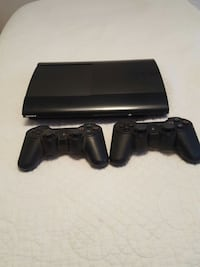 black ps3 super slim console and controllers
