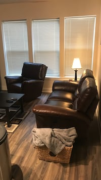 Brown leather love seat (both seats reclinable).  Also pictured, the single chair is a brown leather recliner (also for sale) Alexandria, 22304