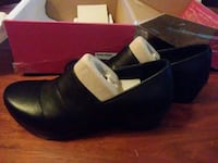 pair of black leather clogs