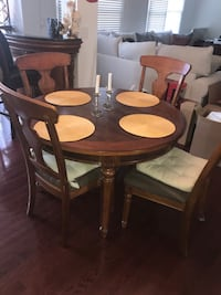 Round brown wooden table with 4 chairs dining set Lorton, 22079