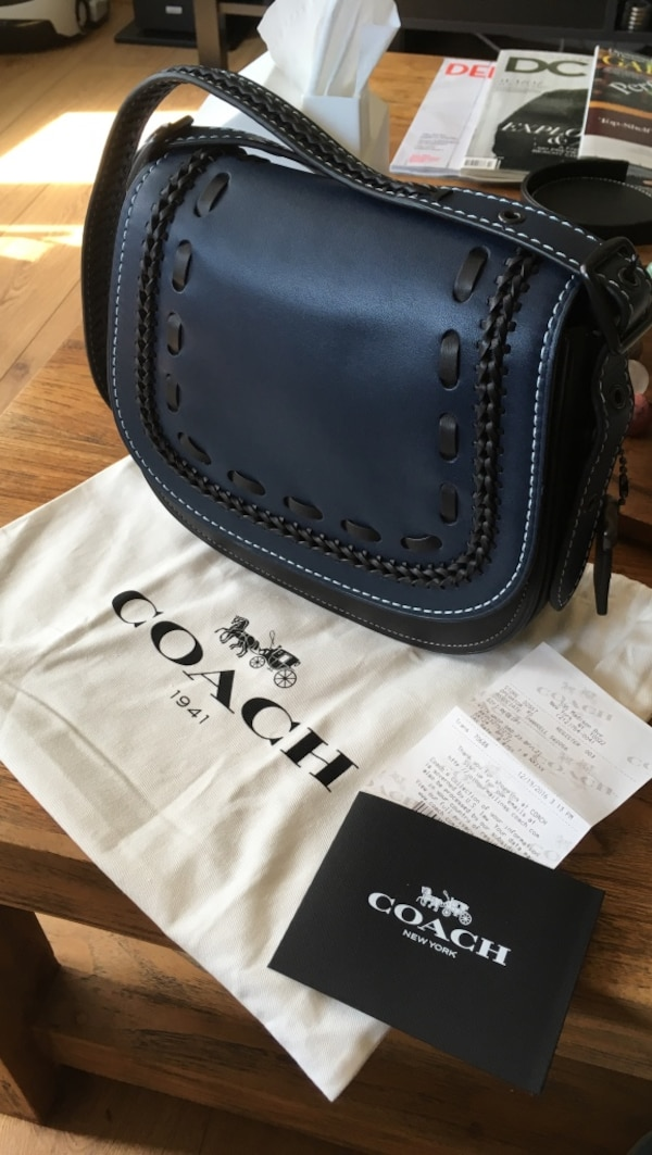 Brand new $550 coach bag with receipt