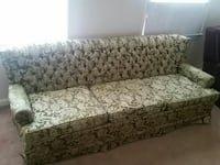gray and white floral fabric sofa