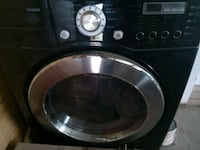 black front-load clothes washer Mission, 78572