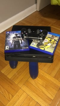 Sony PS4 console with controller and game case