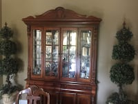 China cabinet. Excellent condition. Glass cabinets above and additional cabinets and drawers below. Lots of storage Orange, 92867