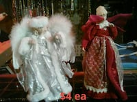 two porcelain dolls with red and white dresses