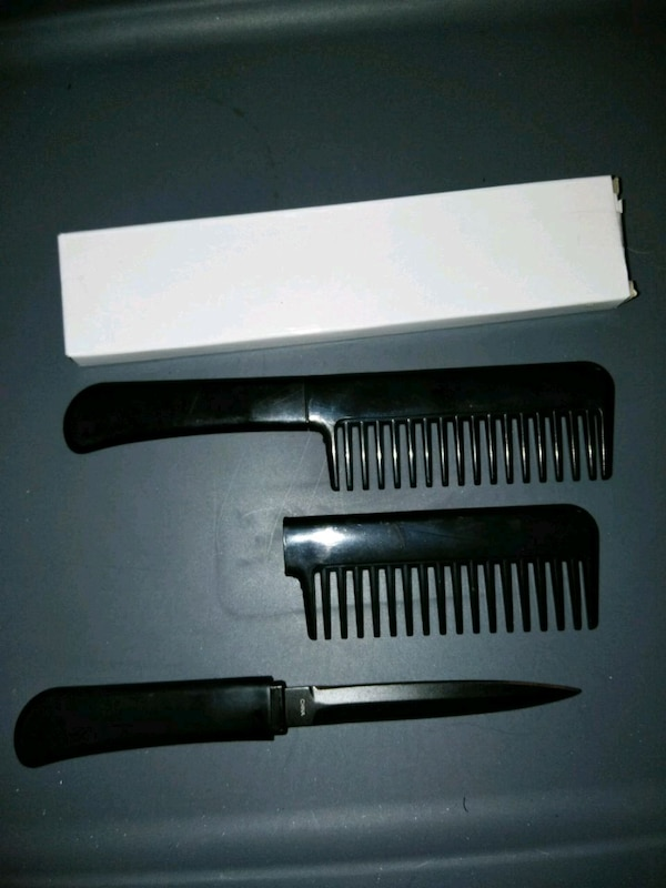 two black plastic hair combs