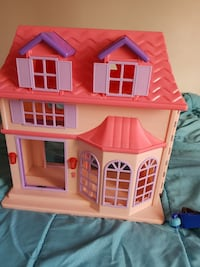 pink and yellow plastic dollhouse Brampton, L6Y 5S5