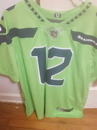 green and black NFL jersey shirt