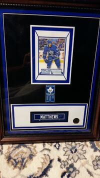 framed  matthews tim horton card,and marner o pee chee rookie Toronto