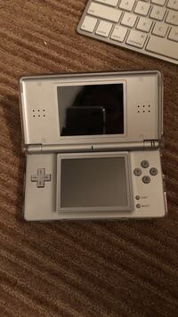 Grey Nintendo DS with game cartridge