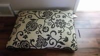 square white and black floral throw pillow