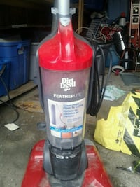 red and black Dirt Devil upright vacuum cleaner Hamilton, L9H