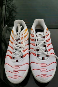 pair of white-and-orange Nike running shoes Mauldin