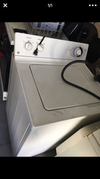 white GE top-load clothes washer