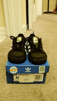 pair of black-and-gold adidas toddler sneakers Athens, 30605