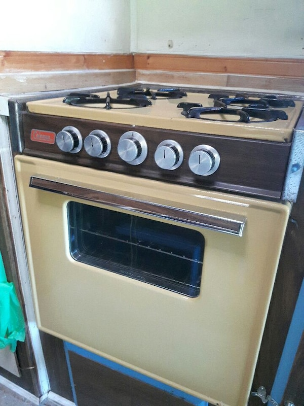 Used Coleman 4 burner propane rv camper stove and oven for