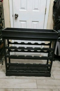 Wine rack holds 24 bottles . Extra space on top . Brooklyn, 11237