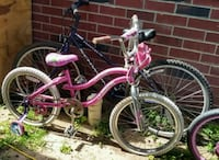 pink and white cruiser bike Mission, 78574