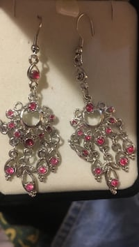 pair of silver-colored chandelier earrings with pink stones