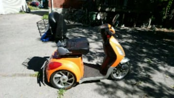 red and black motor scooter