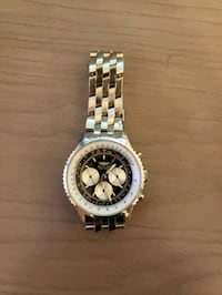 round silver-colored chronograph watch with link bracelet 2061 mi