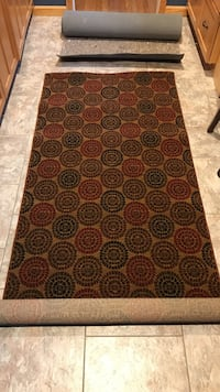 Brown and red kaleidoscope area rug