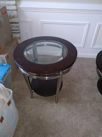 round black wooden framed glass top side table