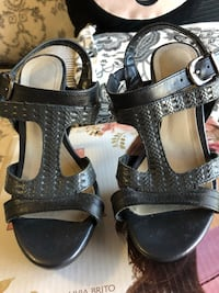 Black and gray heels 1690 mi