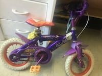 purple and pink bicycle with training wheels Winnipeg