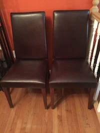 Two brown wooden framed brown leather padded chairs Laurel, 20707