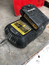 black and yellow DeWalt power tool battery null