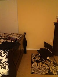 Black sleigh Bed without mattress and dresser Lake Charles