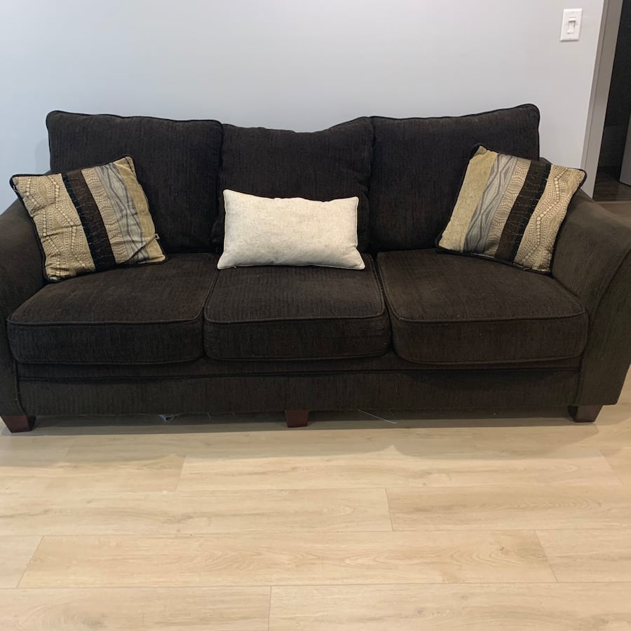 Two brown couches