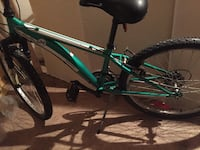 Green and black hardtail mountain bike