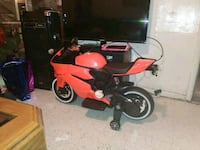 red and black motor scooter 1497 mi