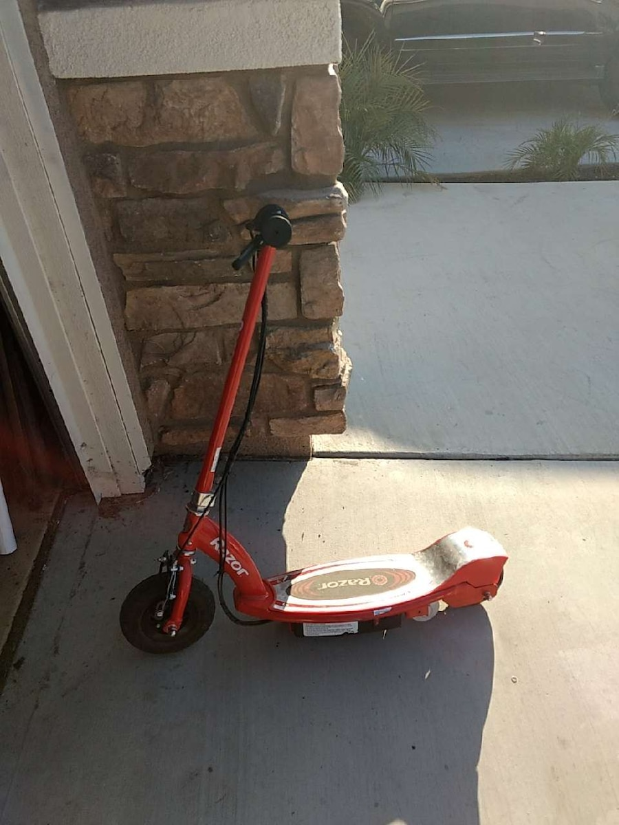 red and gray Razor electric scooter
