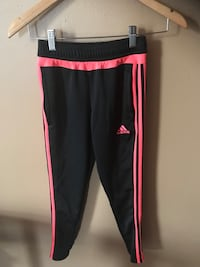 Girls size Small Adidas Black with neon orange stripes it's in excellent condition