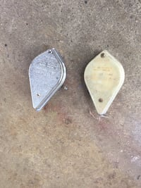Pair of gray metal parts