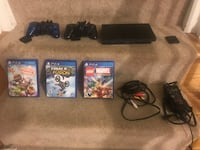 Sony playstation ps2 slim console with 2 controllers and 3 ps4 games Bethesda, 20817