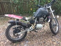 Black and red dirt bike motorcycle Gainesville, 32641