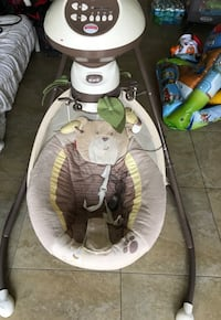 Baby's white and gray cradle and swing Tampa, 33603