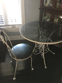 round white metal framed glass top table