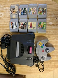 black Nintendo 64 console with controllers and game cartridges Ceres, 95307