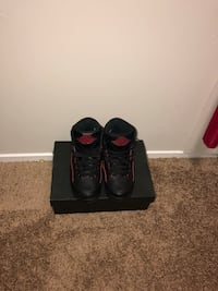 black-and-red Air Jordan basketball shoes Montgomery Village, 20886